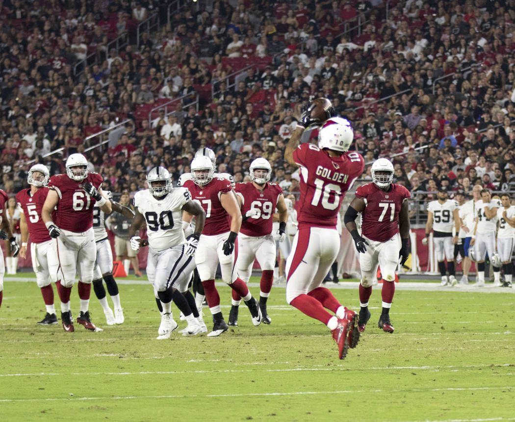Arizona Cardinals wide receiver Brittan Golden (10) catches a pass during the first quarter of an NFL preseason game against the Oakland Raiders in Glendale, Ariz., Saturday, Aug. 12, 2017. Heidi  ...