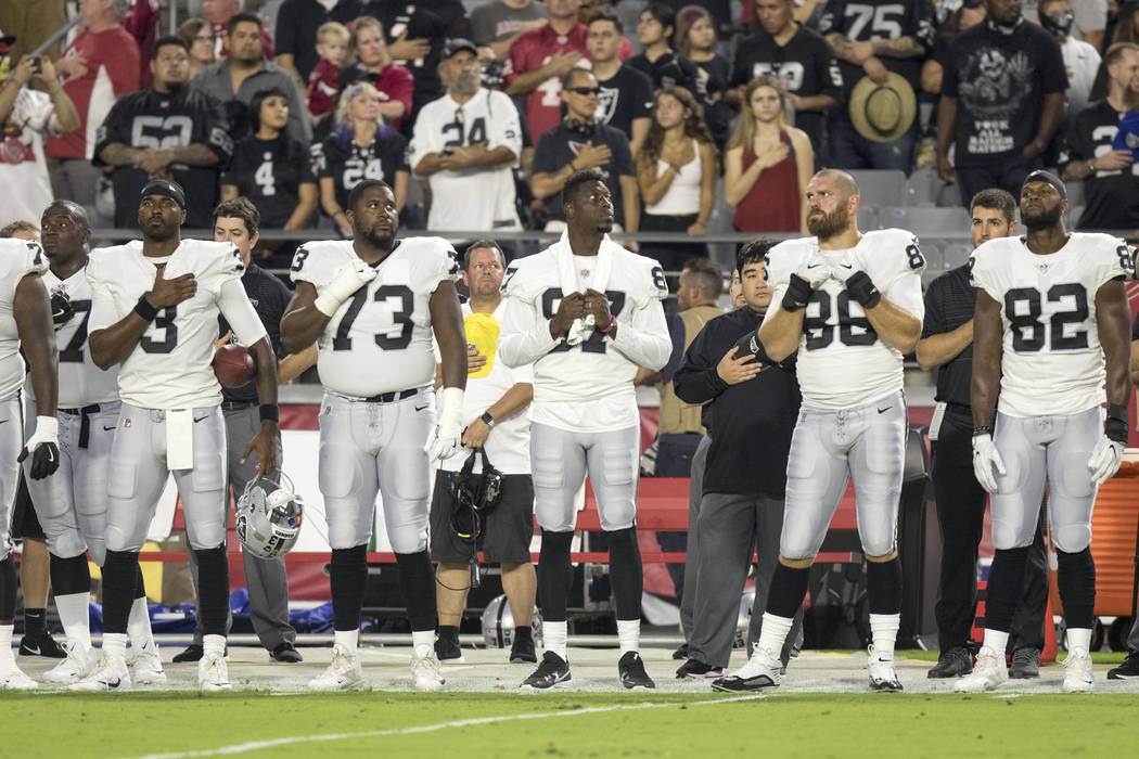 Oakland Raiders players and fans stand during the national anthem during the NFL preseason football game, Saturday, Aug. 12, 2017, in Glendale, Arizona. Heidi Fang Las Vegas Review-Journal @HeidiFang