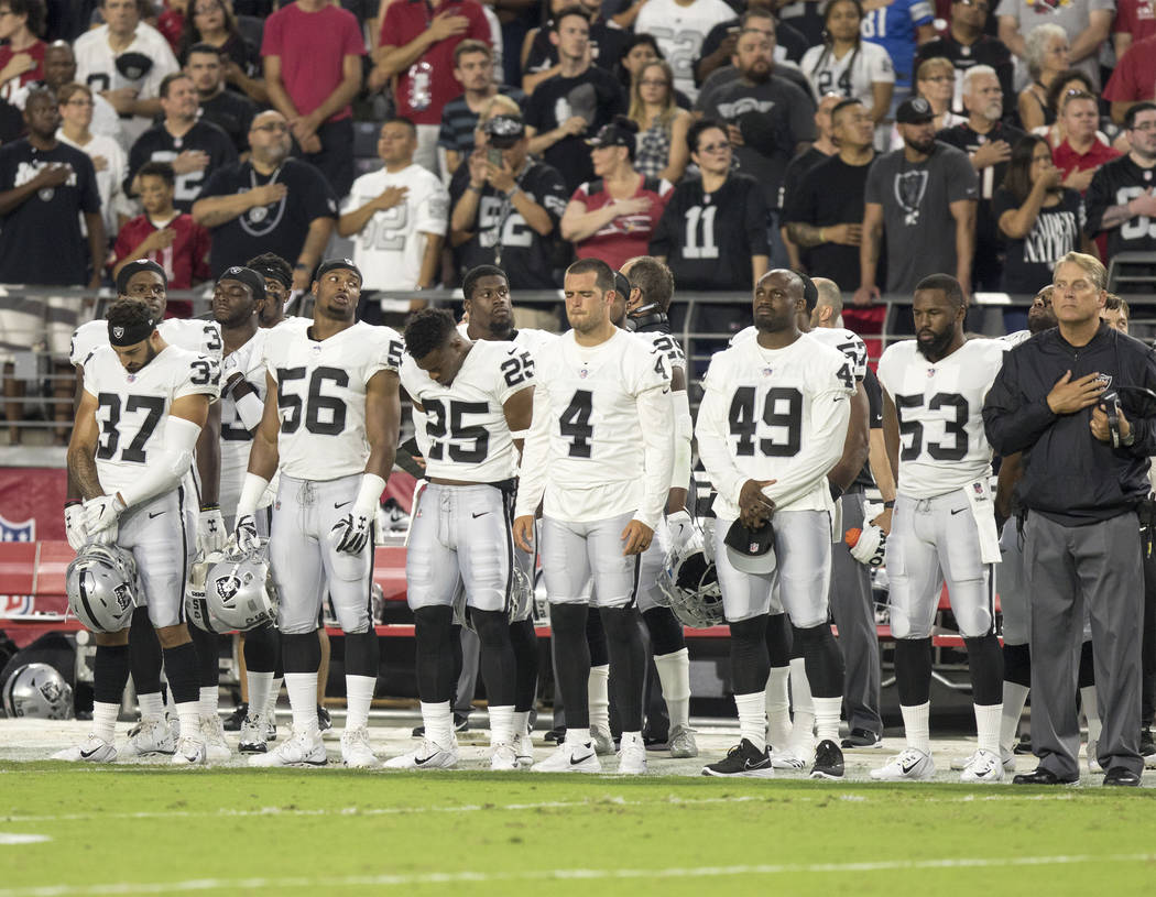 Oakland Raiders players during the national anthem during the NFL preseason football game against the Arizona Cardinals, Saturday, Aug. 12, 2017, in Glendale, Arizona. Heidi Fang Las Vegas Review- ...