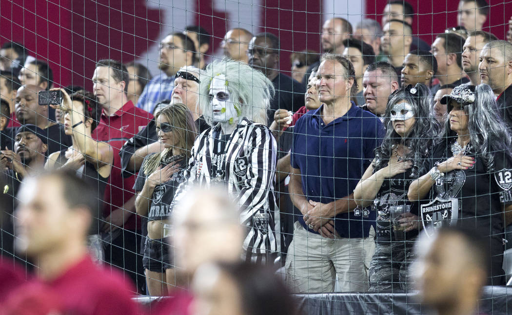 Oakland Raiders fans during the national anthem ahead of the NFL preseason game against the Arizona Cardinals in Glendale, Ariz., on Saturday, August 12, 2017. Heidi Fang/Las Vegas Review-Journal  ...
