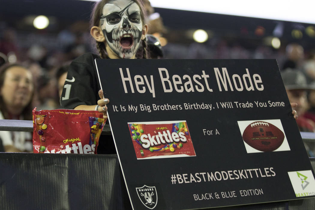 A young fan holds up a sign for Oakland Raiders running back Marshawn Lynch (24), not pictured, at the NFL preseason game against the Arizona Cardinals in Glendale, Ariz., on Saturday, August 12,  ...