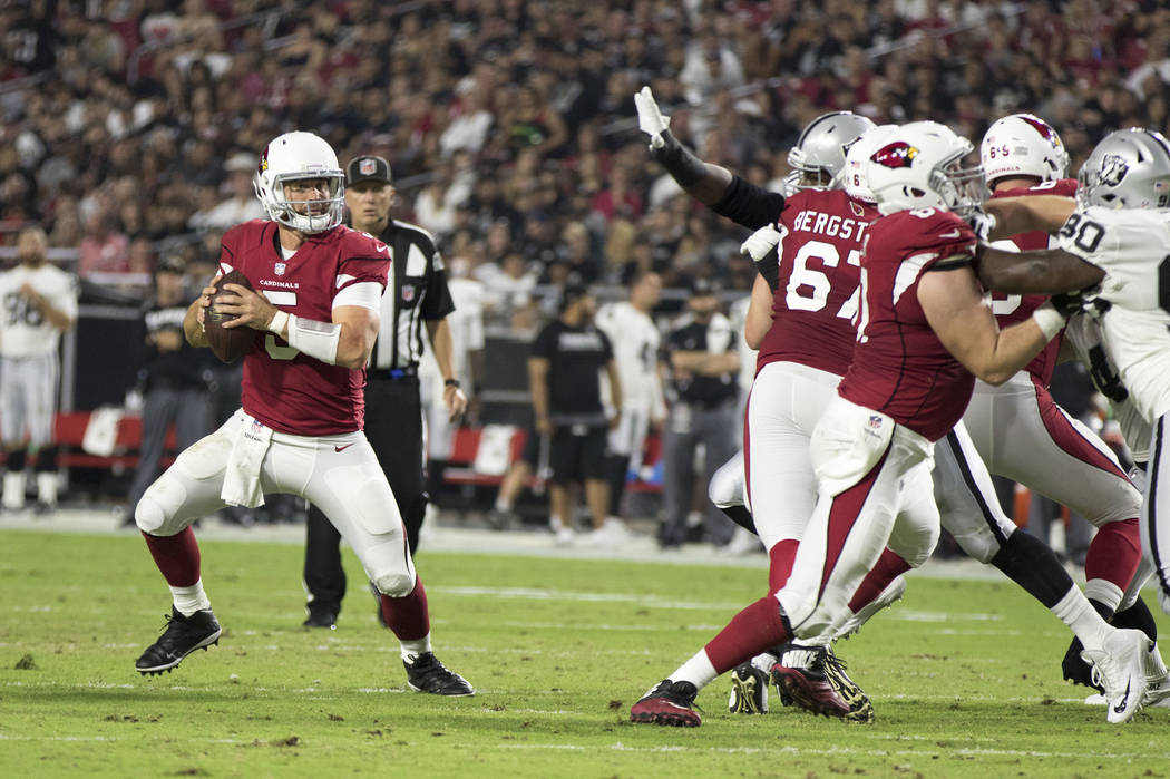 Arizona Cardinals quarterback Drew Stanton scrambles to find an open receiver during the second quarter of a NFL preseason game against the Oakland Raiders in Glendale, Ariz., on Saturday, August  ...