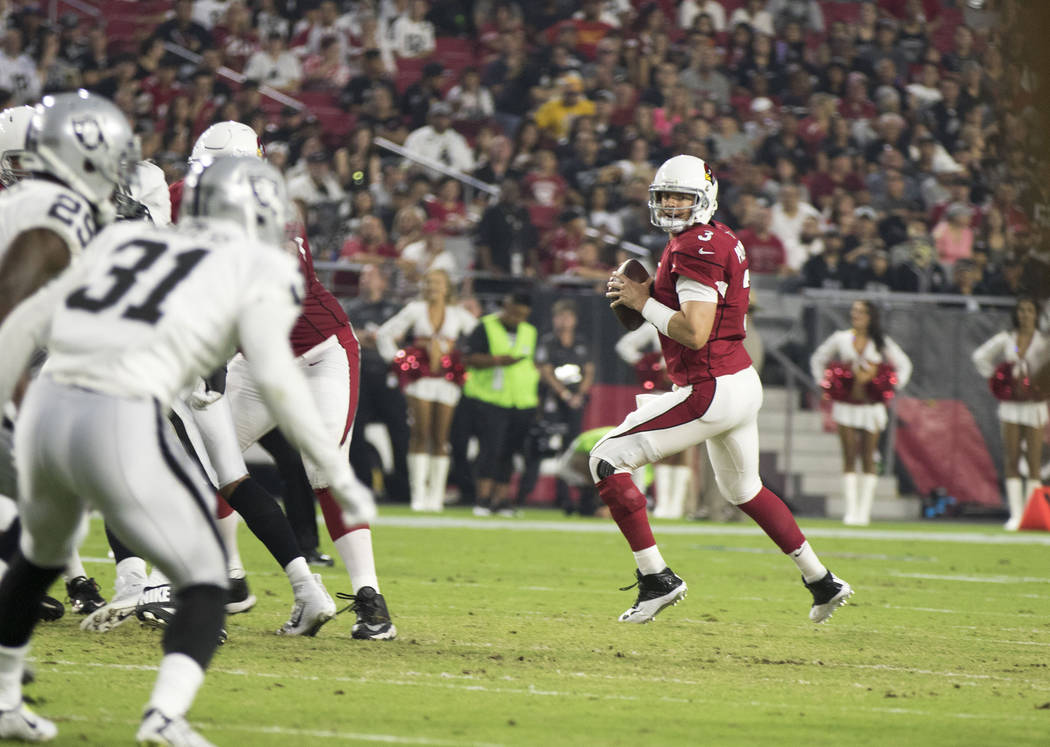 Arizona Cardinals quarterback Carson Palmer (3) prepares to throw the football during the first quarter of a NFL preseason game against the Oakland Raiders in Glendale, Ariz., on Saturday, Aug. 12 ...