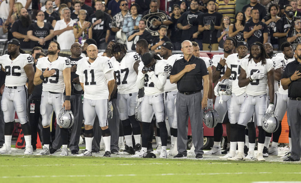 Oakland Raiders players during the national anthem at the NFL preseason football game against the Arizona Cardinals in Glendale, Ariz., on Saturday, Aug. 12, 2017. Heidi Fang/Las Vegas Review-Jour ...