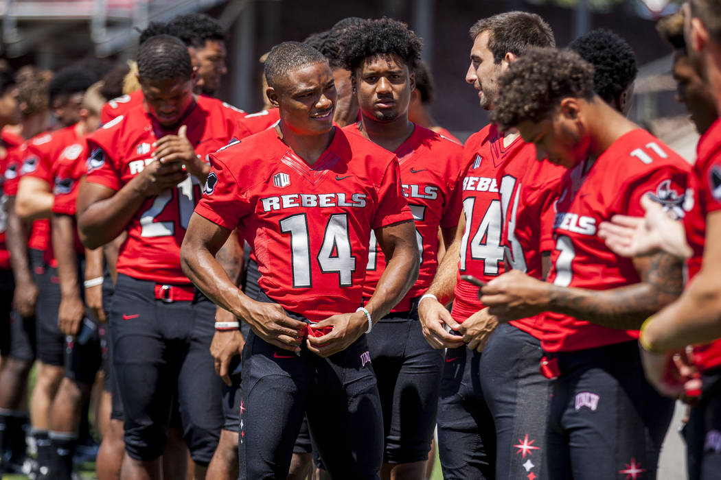 UNLV football players line up during photo day at Sam Boyd Stadium on Monday, Aug. 7, 2017.  Patrick Connolly Las Vegas Review-Journal @PConnPie