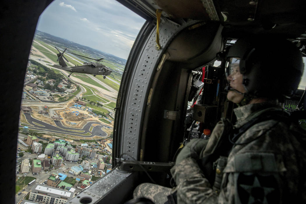 A helicopter carrying Joint Chiefs Chairman Gen. Joseph Dunford and United States Forces Korea Commander Gen. Vincent Brooks, left, takes a familiarization flight, Sunday, Aug. 13, 2017, near Pyeo ...