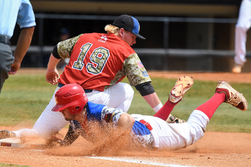 Martin Money of Midland Mich. safely lands under the tag of Southern Nevada Blue Sox's Jack-Thomas Wold (19) during the game 10 of The American Legion World Series on Sunday, August 13, 2017 in Sh ...