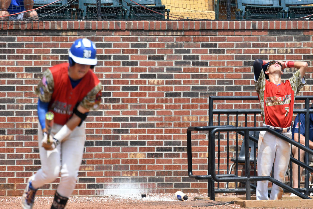 Southern Nevada Blue Sox's John Howard Bobo, right, reacts to teammate Jesse Fonteboa's infield pop-up against Midland Mich. during the game 10 of The American Legion World Series on Sunday, Augus ...