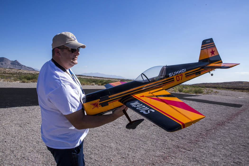Robert Slauson carries his remote-controlled airplane at the Las Vegas Soaring Club field near Red Rock Canyon on Sunday, Aug. 13, 2017.  Patrick Connolly Las Vegas Review-Journal @PConnPie