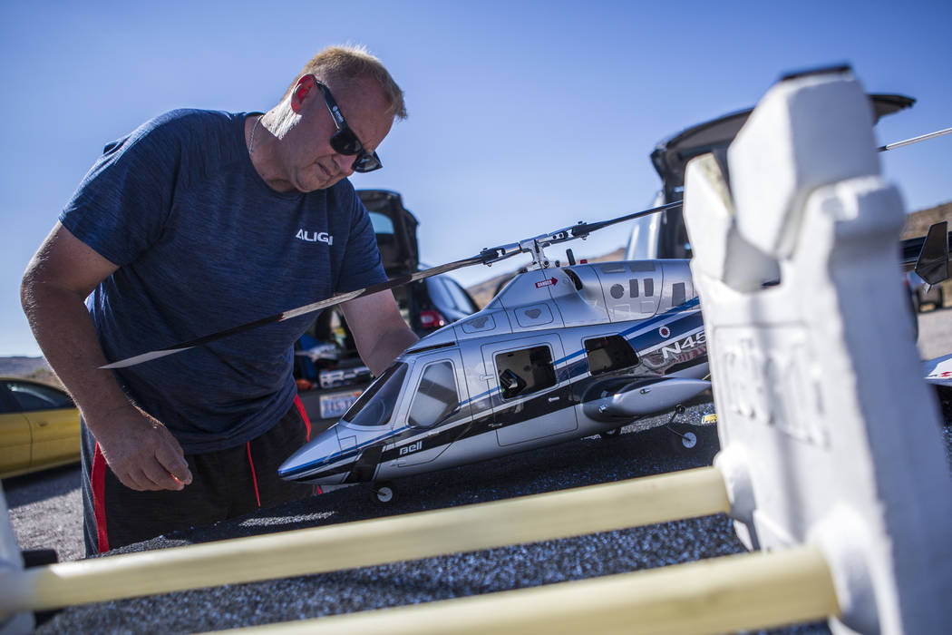 Barry Mattison, president of the Las Vegas Soaring Club, works on his remote-controlled helicopter at the club's field near Red Rock Canyon on Sunday, Aug. 13, 2017. Mattison has been flying since ...