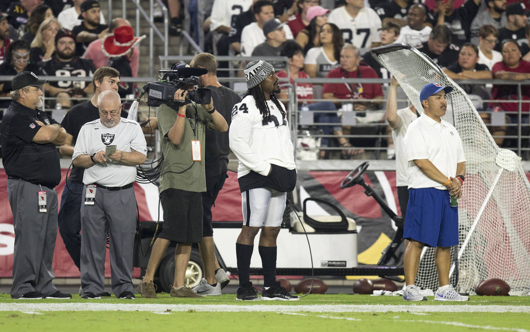 Oakland Raiders running back Marshawn Lynch (24) on the sideline during the first quarter of a NFL preseason game against the Arizona Cardinals in Glendale, Ariz., on Saturday, Aug. 12, 2017. Heid ...