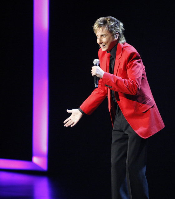 """Platinum recording artist Barry Manilow performs a song during his show show """"Manilow Music and Passion"""" at the Las Vegas Hilton hotel-casino, Friday, July 31, 2008. (John Locher ..."""