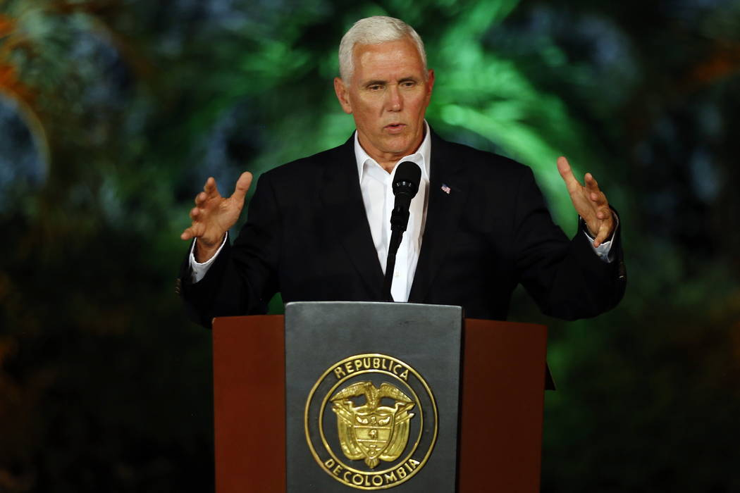 U.S. Vice President Mike Pence speaks during a joint press conference with Colombia's President Juan Manuel Santos at the presidential guesthouse in Cartagena, Colombia, Sunday, Aug. 13, 2017. Car ...