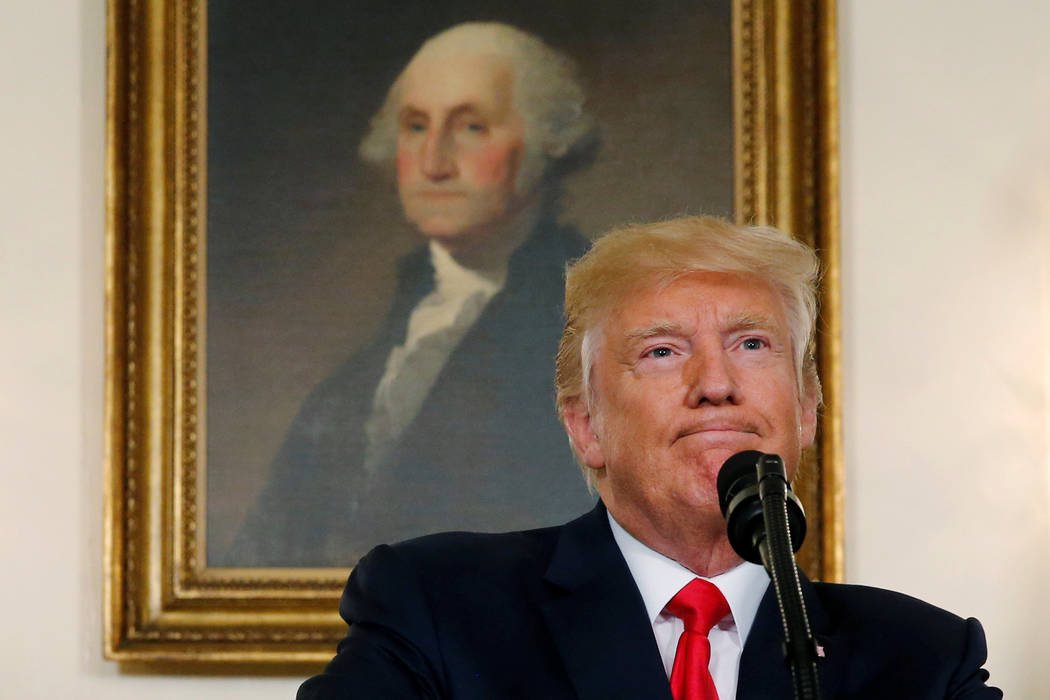 U.S. President Donald Trump pauses during a statement on the deadly protests in Charlottesville, at the White House in Washington, U.S., August 14, 2017.  REUTERS/Jonathan Ernst     TPX IMAGES OF  ...