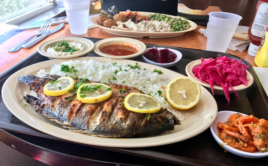 The grilled tilapia dish ($12.95) can also be fried. Extra pita, baba ghannouj, hummus, side salads, fries and rice can be added for an additional charge. (Madelyn Reese/View) @MadelynGReese