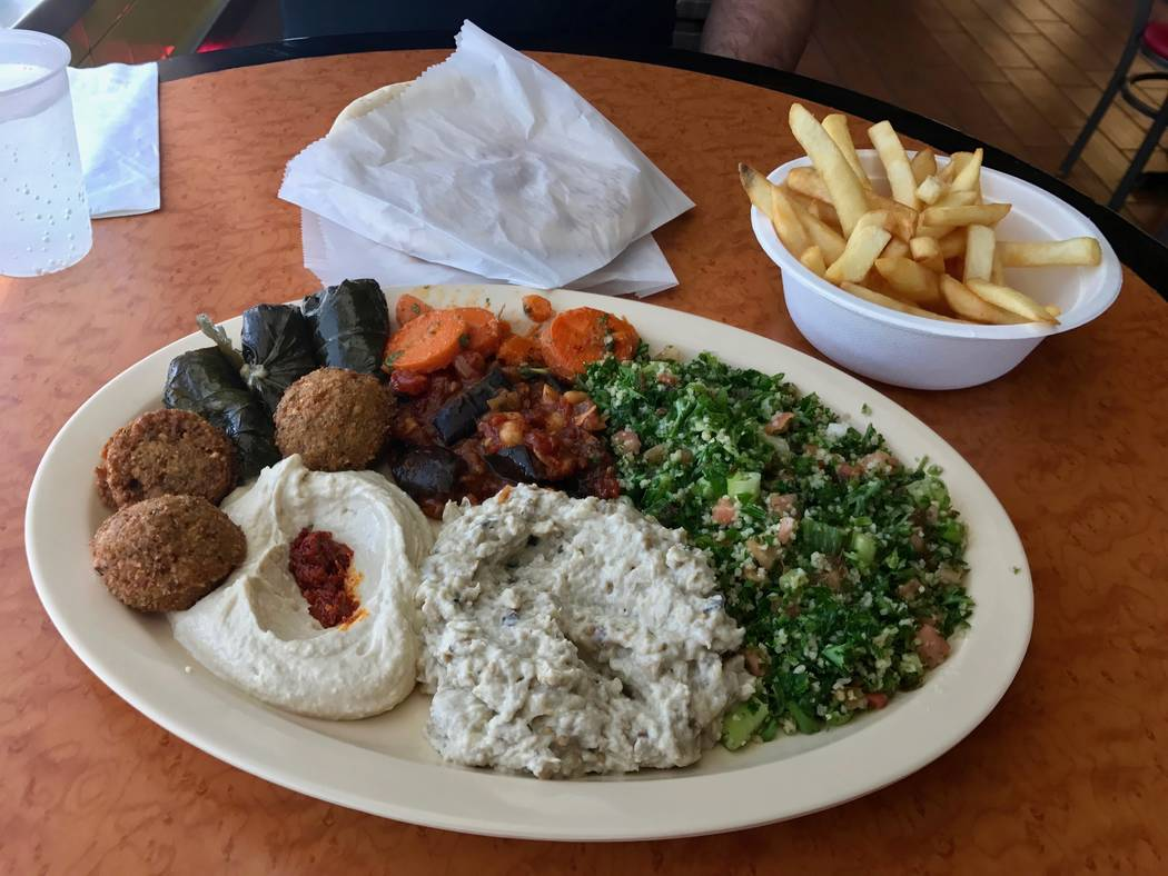 Vegetarian plate with dolma, falafel, salad, hummus, pita, eggplant salad, baba ghannouj, carrots and french fries ($11.95). (Madelyn Reese/View) @MadelynGReese