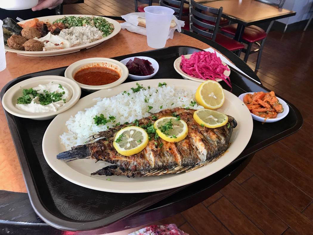 Grilled tilapia with white rice, beets, carrots, hummus and cabbage ($12.95). (Madelyn Reese/View) @MadelynGReese