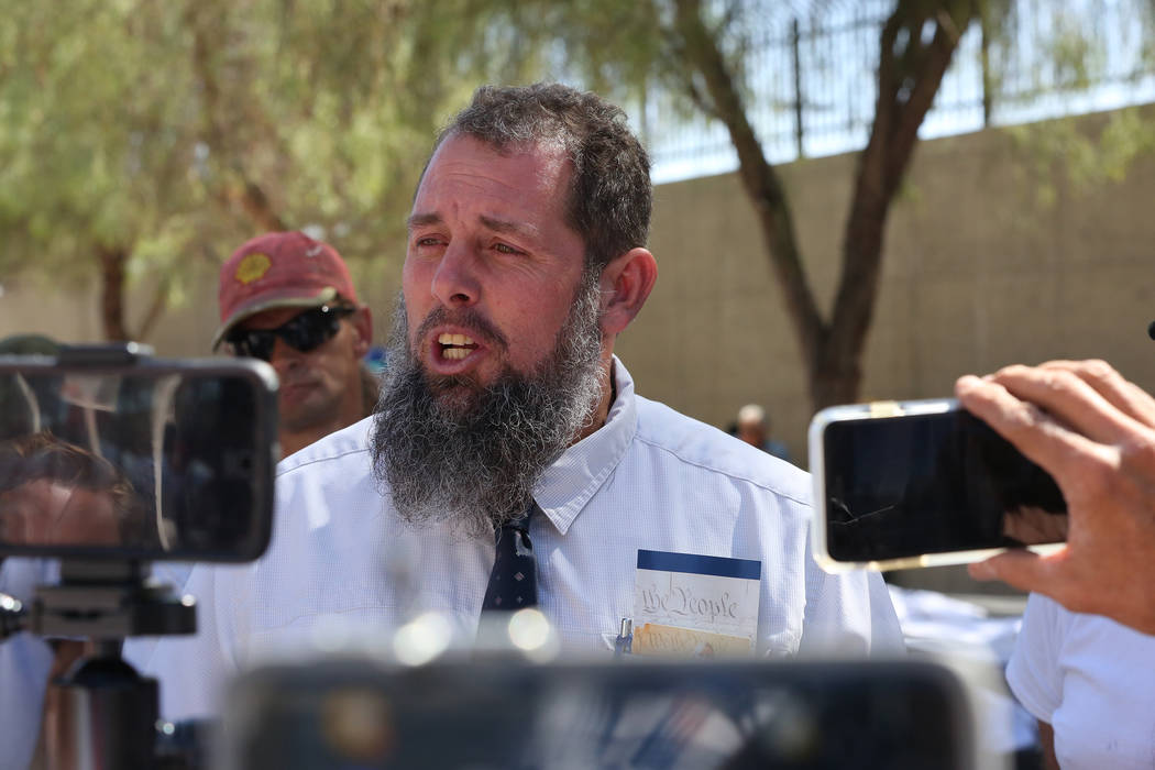 John Lamb, left, of Bozeman, Mont. speaks to a crowd of protesters and media outside the federal courthouse in Las Vegas on Monday , Aug. 14, 2017 during the Bunkerville standoff retrial. Michael  ...