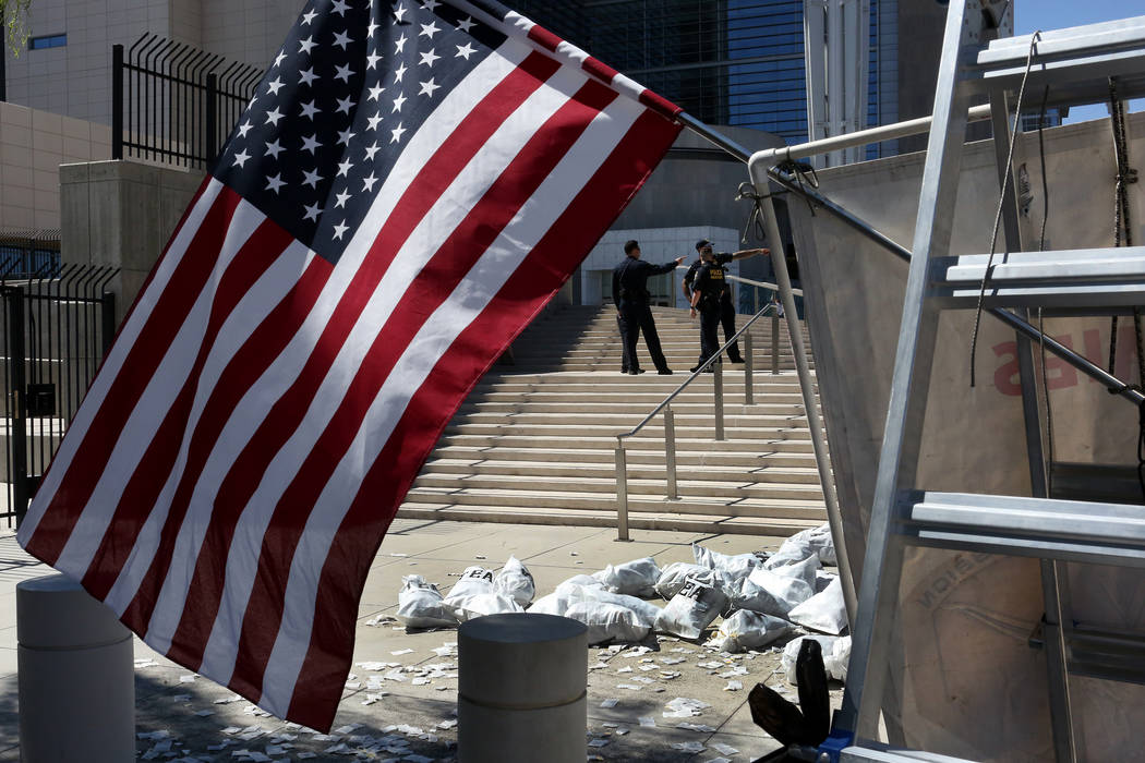 Bags of tea placed by protesters lie in a pile at the foot of the steps to the federal courthouse in Las Vegas on Monday , Aug. 14, 2017 during the Bunkerville standoff retrial. Michael Quine Las  ...