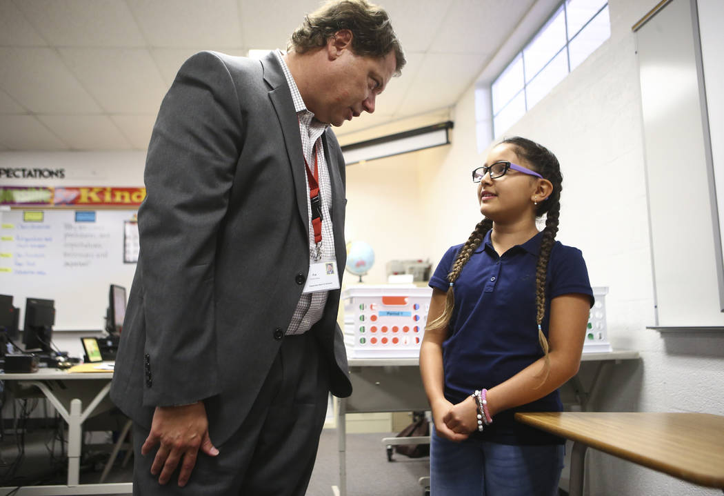 Seventh-grader Andrea Perez Lamas, 12, an English language learning student, talks with Clark County School District Superintendent Pat Skorkowsky during the first day of classes at Garside Junior ...