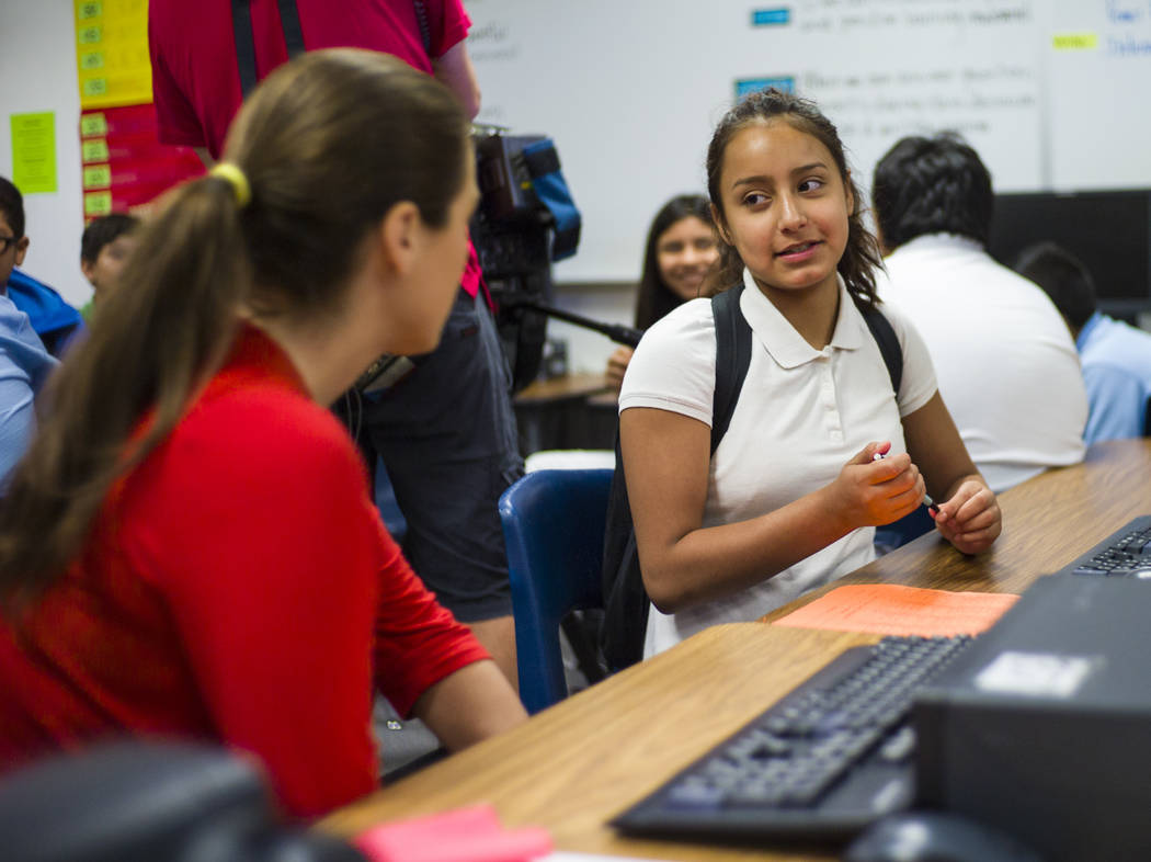 Clark County School Board District Trustee Lola Brooks, left, talks with seventh-grader Emely Sanchez, 12, an English language learning student, during the first day of classes at Garside Junior H ...