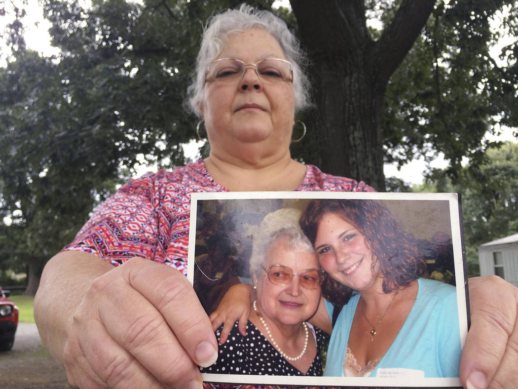 Susan Bro, the mother of Heather Heyer, holds a photo of Bro's mother and her daughter, Monday, Aug. 14, 2017, in Charlottesville, Va. Heyer was killed Saturday, Aug. 12, 2017, when police say a m ...