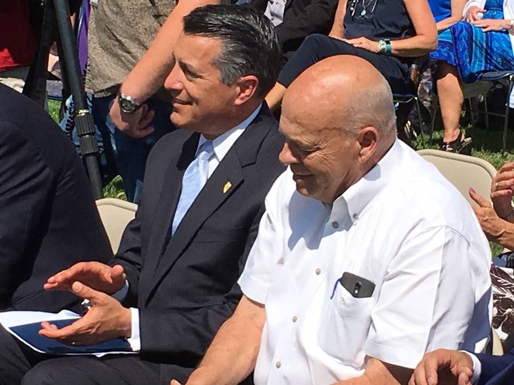 Sandoval and Assemblyman Jim Wheeler, R-Gardnerville, during comments at the health exchange announcement on Tuesday, Aug. 15, 2017. Sandoval announced that 14 rural Nevada counties will have an i ...