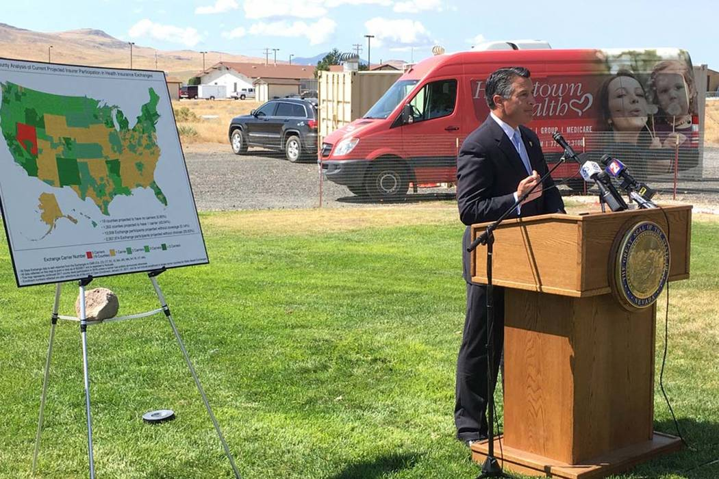 Gov. Brian Sandoval announces an insurance carrier to provide service in 14 rural counties on Nevada's health insurance exchange at a press conference in Silver Springs on Tuesday, Aug. 15, 2017 ...