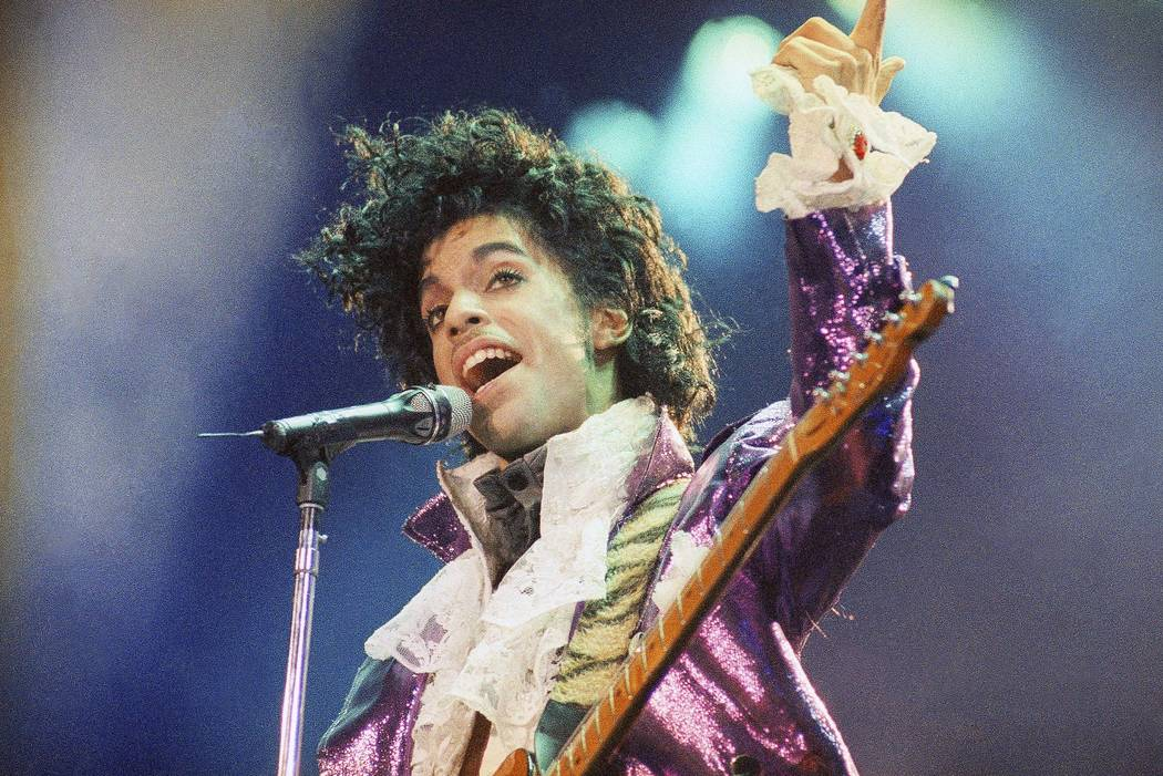 Prince performs at the Forum in Inglewood, Calif., Feb. 18, 1985. The Pantone Color institute and the estate of the late music superstar announced a new shade of purple on Monday, Aug. 14, 2017, n ...