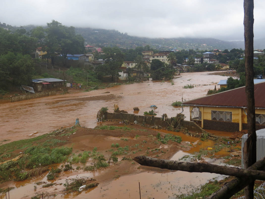 A torrent of water flows through a flooded neighbourhood in Regent, east of Freetown, Sierra Leone Monday, Aug. 14 , 2017. Mudslides and torrential flooding killed many people in and around Sierra ...