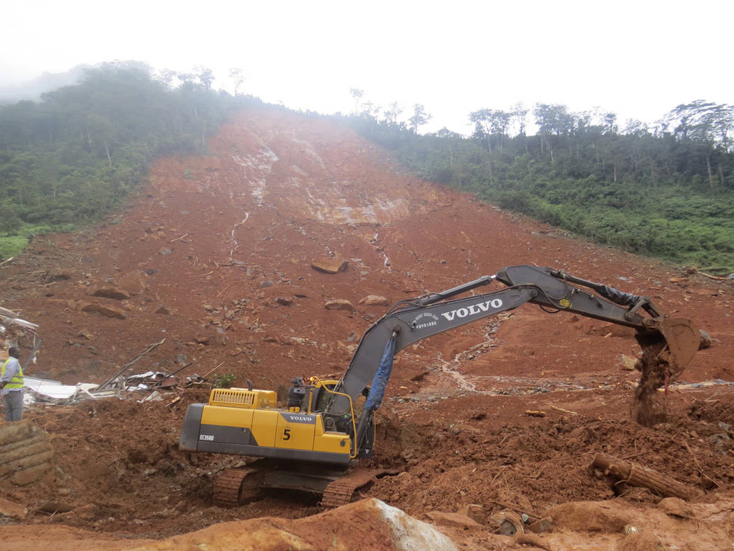 Heavy equipment is used as rescue workers search for survivors and victims following a mudslide in Regent, east of Freetown, Sierra Leone, Monday, Aug. 14, 2017.  Mudslides and torrential flooding ...