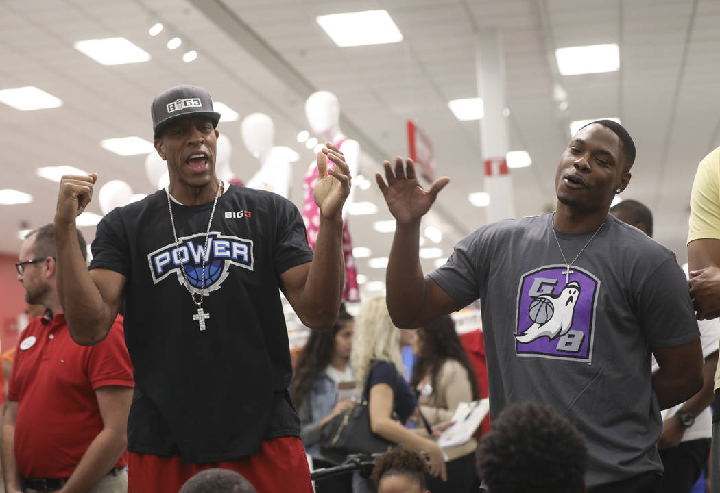 Former NBA player Jerome Williams, left, and former UNLV and NBA player Marcus Banks during an event held by the Nevada Partnership for Homeless Youth and the Big 3 at Target, 8750 W. Charleston B ...