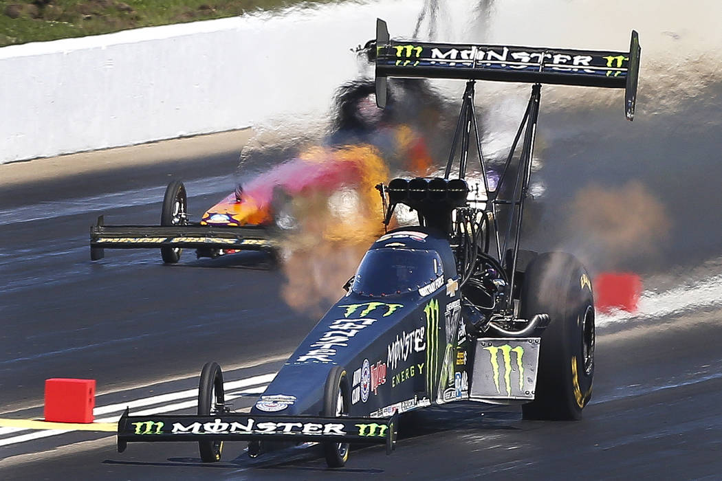 Brittany Force, bottom, drives her top fuel dragster during the first round of eliminations at the NHRA Heartland Nationals on Sunday, May 21, 2017, in Topeka, Kan. (Chris Neal/The Topeka Capital- ...