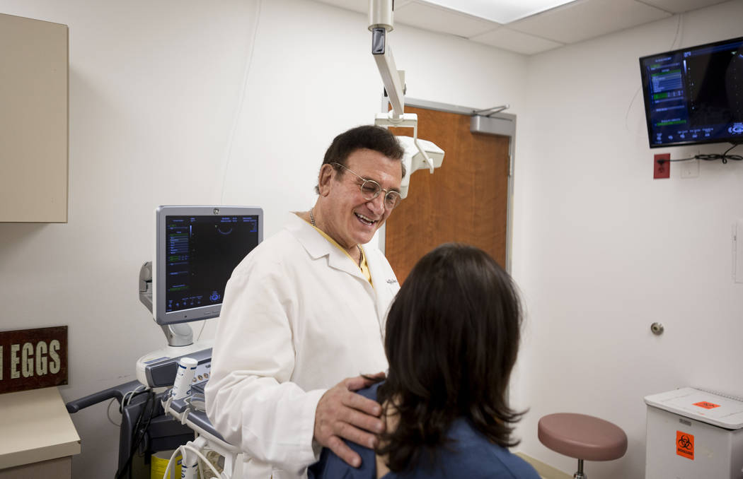 Dr. Geoffrey Sher, one of the world's top fertility doctors, speaks with a patient about to undergo a procedure to collect her eggs to then bank her embryos at Sher Fertility clinic in Las Vegas,  ...