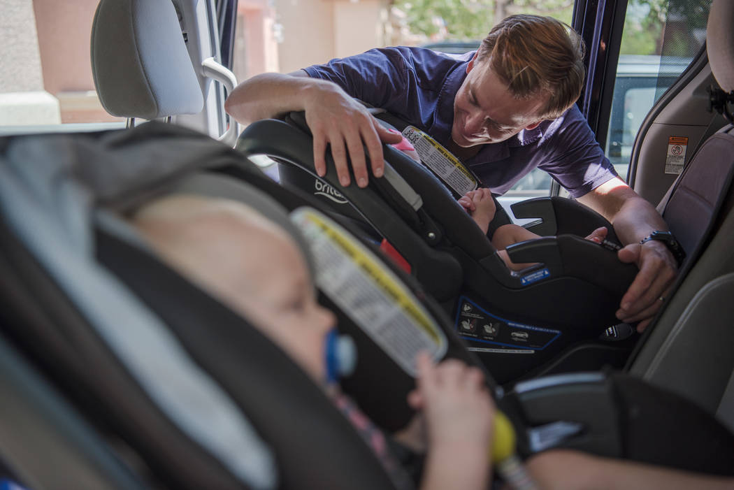 Aaron Barborka with his twins, Henry and Lorea, outside the Barborka home on Tuesday, Aug. 15, 2017, in Las Vegas. (Morgan Lieberman/Las Vegas Review-Journal)