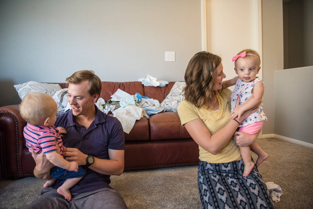 Aaron and Megan Barborka with their twins, Henry and Lorea, in the Barborka home on Tuesday, Aug. 15, 2017, in Las Vegas. (Morgan Lieberman/Las Vegas Review-Journal)