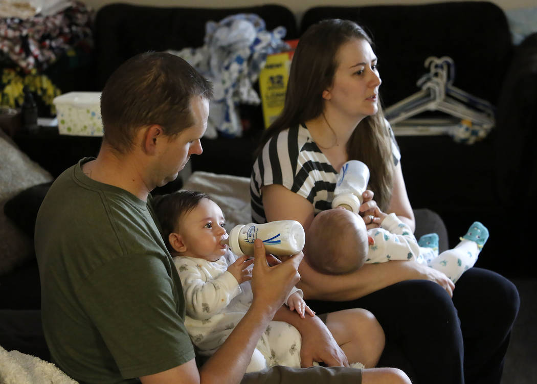 Heather Lynch, and her husband Andrew bottle feed their 5-month-old fraternal twin sons Benson, left, and Anakin at their Las Vegas home on Friday, Aug. 18, 2017. (Bizuayehu Tesfaye/Las Vegas Revi ...