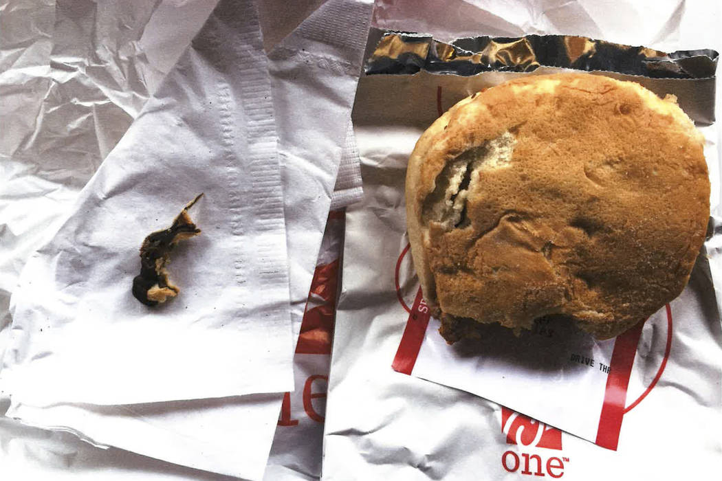The remains of a rodent, left, she alleges she found baked into the bun of a chicken sandwich, right, that a co-worker purchased for her that day at a Chick-fil-A franchise restaurant in Langhorne ...