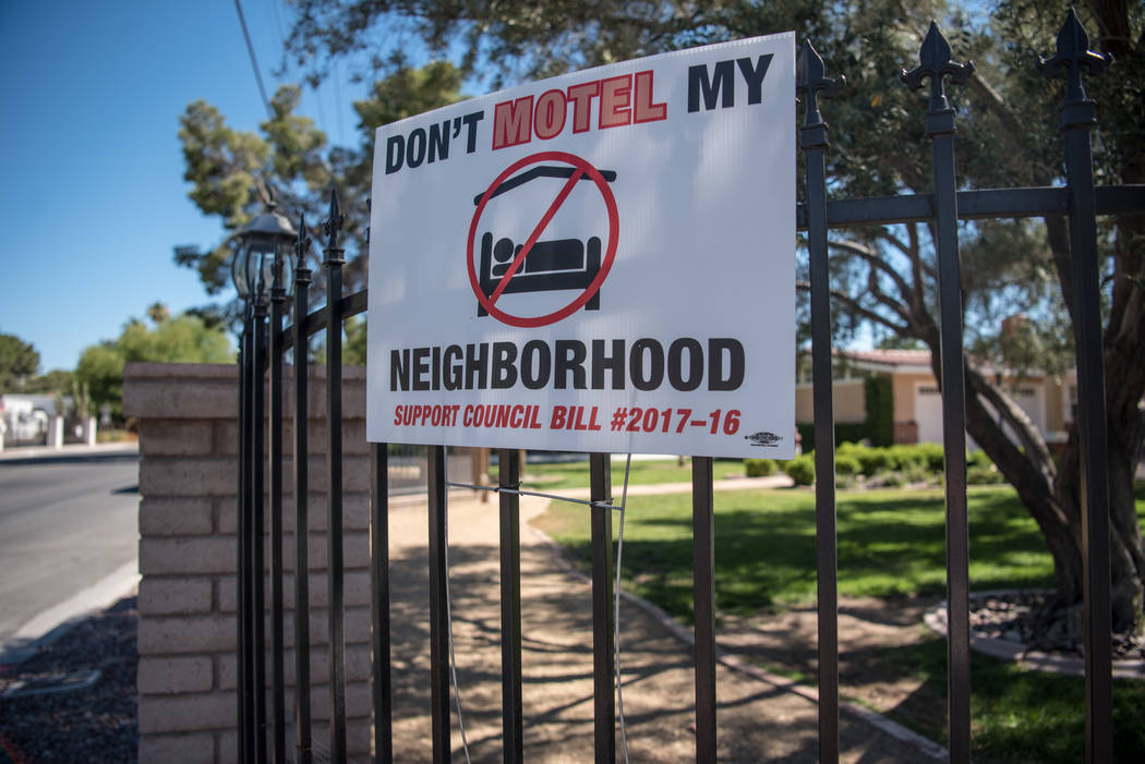 "Shadow Lane exhibiting their ""Don't Motel My Neighborhood"" signs on Wednesday, June 14, 2017, in Las Vegas. Las Vegas is going live with a new fix for problematic party houses Tuesday, Aug. 15, 20 ..."