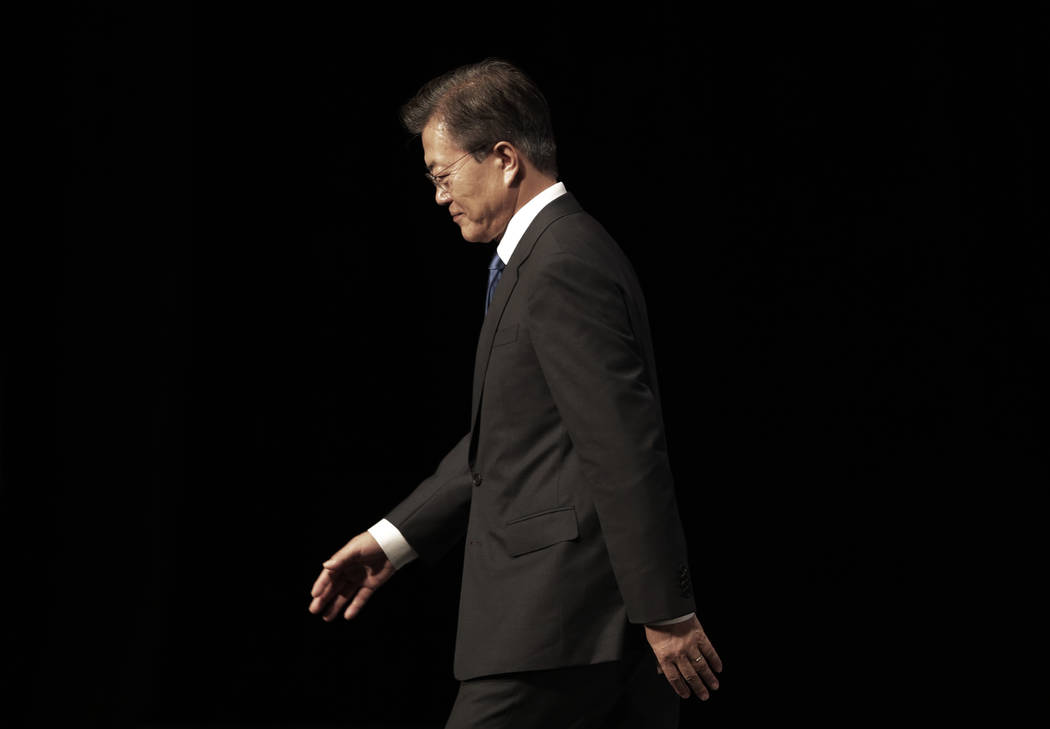 South Korean President Moon Jae-in leaves after a ceremony to celebrate Korean Liberation Day, at Seong Cultural Center in Seoul, South Korea, Tuesday, Aug. 15, 2017. Moon, in a televised speech T ...