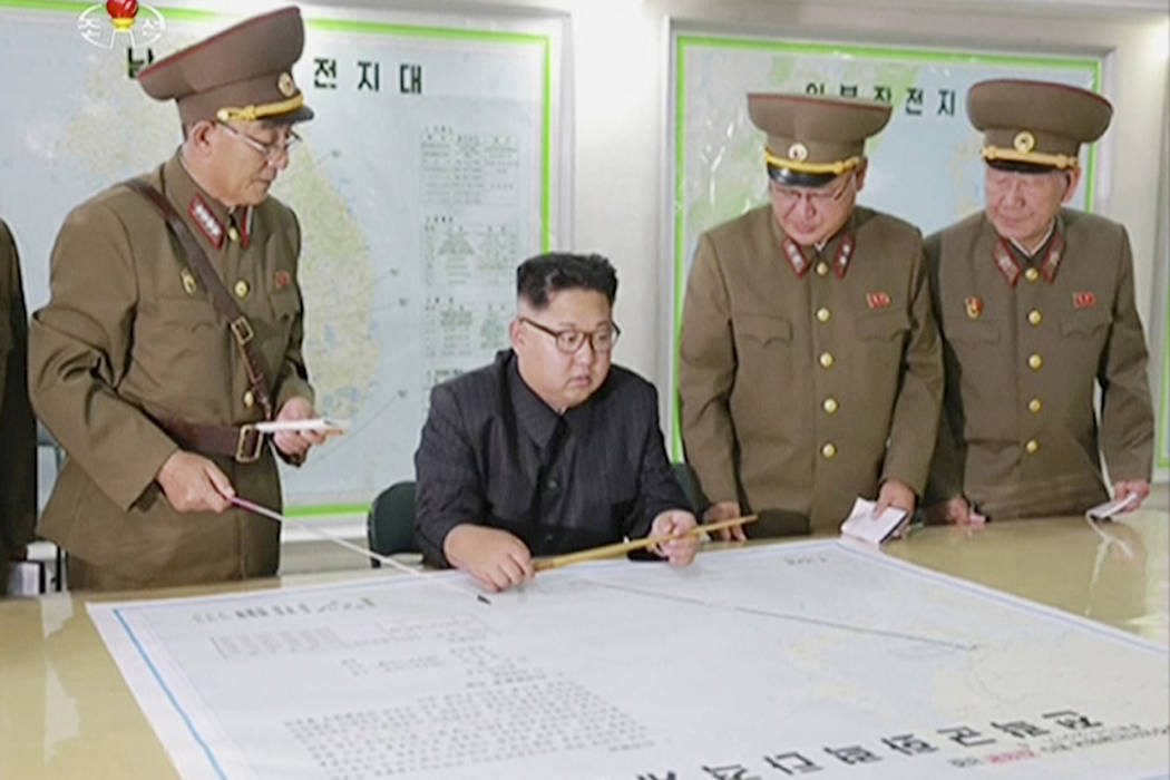 This image made from video of an Aug. 14, 2017, still image broadcast in a news bulletin Tuesday, Aug. 15, 2017, by North Korea's KRT shows North Korean leader Kim Jong Un receiving a briefing in  ...