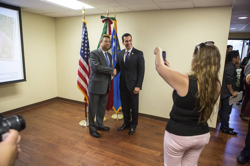 Mexican Consul Alejandro Madrigal, left, and Rep. Ruben Kihuen, D-Nev., take a photo together during  a Deferred Action for Childhood Arrivals (DACA) anniversary event at the Consulate of Mexico i ...
