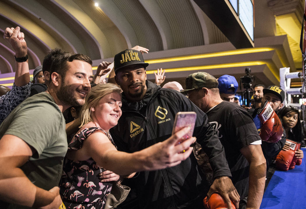 Light heavyweight boxer Badou Jack, middle, takes photos wth fans after open workouts on Wednesday, Aug 23, 2017, at the MGM Grand casino-hotel, in Las Vegas. Benjamin Hager Las Vegas Review-Journ ...