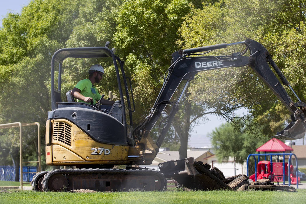 Construction workers Brian Holm at Alexander Villas Park, which is closed for construction improvements by Clark County in Las Vegas, on Tuesday, Aug. 15, 2017. Erik Verduzco Las Vegas Review-Jour ...