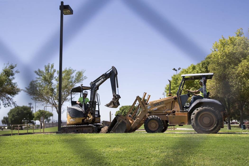 Construction workers Brian Holm, left, and Nathan Williams at Alexander Villas Park, which is closed for construction improvements by Clark County in Las Vegas, on Tuesday, Aug. 15, 2017. Erik Ver ...