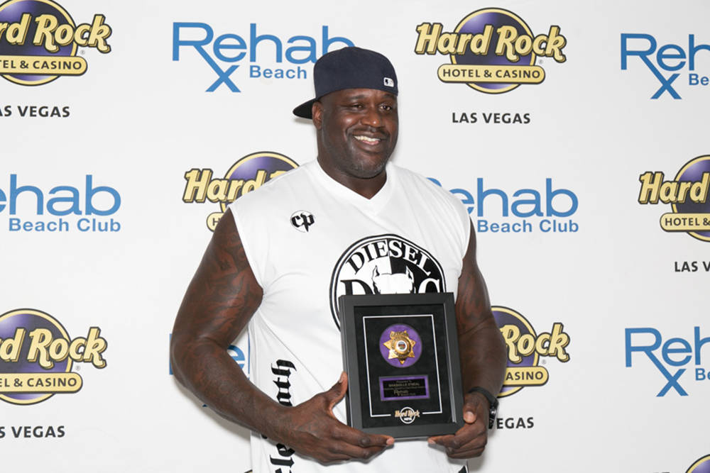 """Shaquille O'Neal was presented with a plaque and honored by Hard Rock as an """"Honorary Sheriff to Rehab Beach Club.""""  (Jeff Ragazzo/Kabik Photo Group)"""