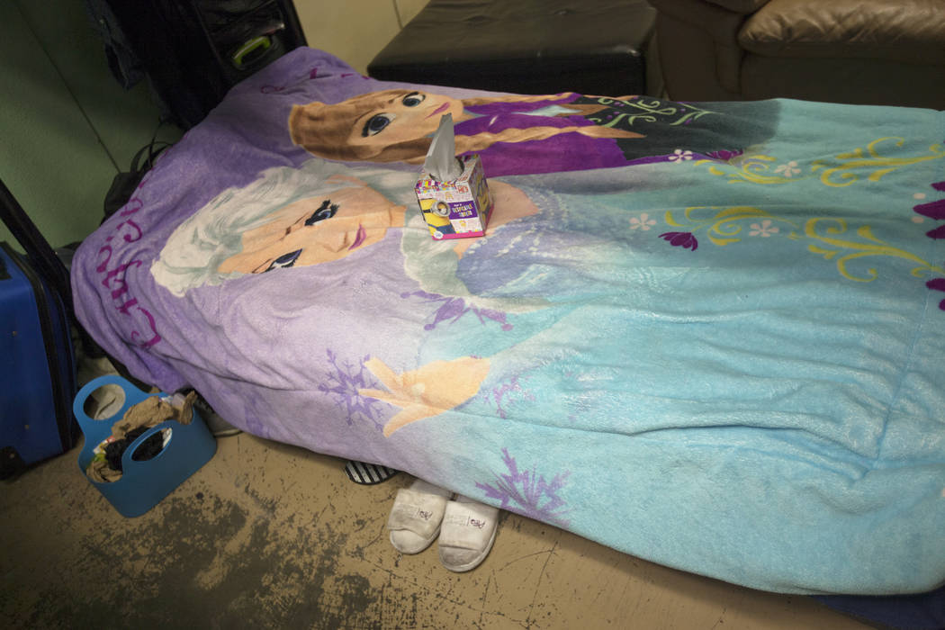 A kleenex box on a bed in the family dorm area at The Shade Tree women's shelter on Thursday, Aug. 24, 2017, in Las Vegas. The shelter serves women and children, especially those facing domestic v ...