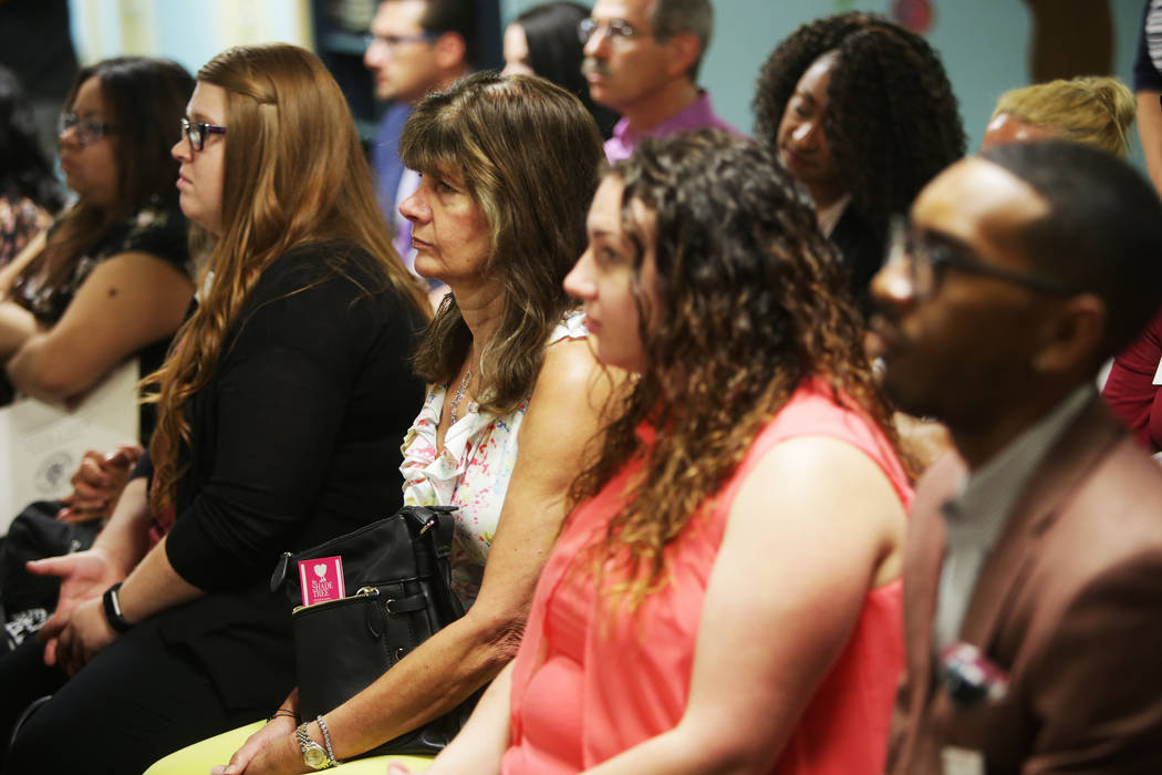 The audience listens to The Shade Tree administration members about the importance of their organization on Thursday, Aug. 24, 2017, at a fundraiser at The Shade Tree in Las Vegas. The shelter ser ...