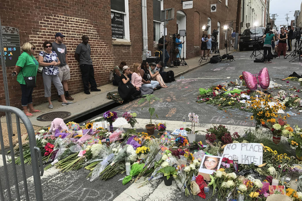 A makeshift memorial was assembled at a downtown intersection in Charlottesville, Virginia, where violence erupted this weekend between white nationalists and counter-protesters over the relocatio ...