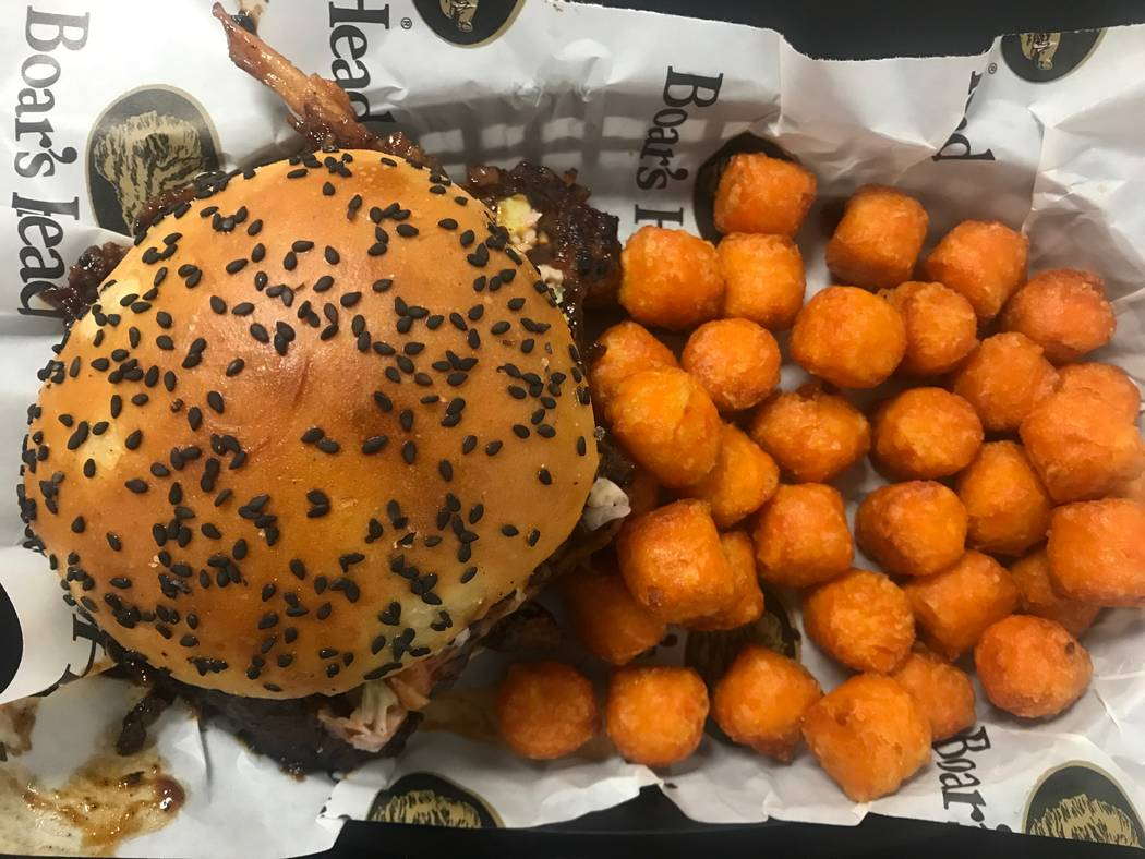 The BBQ pulled chicken sandwich is served with sweet potato tots on July 11, 2017 at Chip off the Block Deli, 6440 N. Durango Drive. (Kailyn Brown/ View) @KailynHype